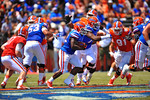Florida RB Adam Lane Jr. looks for the open hole after getting the handoff.  2014 Orange and Blue Debut.  April 12th, 2014. Gator Country photo by David Bowie.