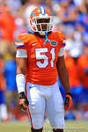 Florida LB Michael Taylor looks to the sideline for the play call.  Country photo by David Bowie.