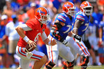 Florida QB Jeff Driskel keeps the ball and sprints downfield.  2014 Orange and Blue Debut.  April 12th, 2014. Gator Country photo by David Bowie.