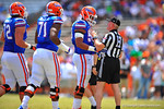 Florida OL Kavaris Harkless talks with a referee after a play.  2014 Orange and Blue Debut.  April 12th, 2014. Gator Country photo by David Bowie.