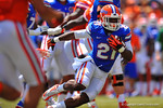 Florida RB Kelvin Taylor finds the open hole and sprints for a first down to the 1 yard line.  2014 Orange and Blue Debut.  April 12th, 2014. Gator Country photo by David Bowie.