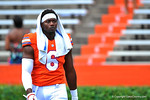 Florida DL Dante Fowler, Jr. walks off the field with a towel draped over his head.  2014 Orange and Blue Debut.  April 12th, 2014. Gator Country photo by David Bowie.