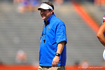 Gator Head Coach Will Muschamp smiles as he looks to the sidelines.  2014 Orange and Blue Debut.  April 12th, 2014. Gator Country photo by David Bowie.