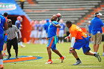 Former Gator football players compete in a flag football game.  2014 Orange and Blue Debut.  April 12th, 2014. Gator Country photo by David Bowie.