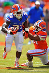 Florida LB Michael Taylor tries to bring down a sprinting Mack Brown.  2014 Orange and Blue Debut.  April 12th, 2014. Gator Country photo by David Bowie.