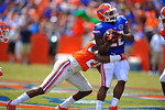 Florida DB Marcell Harris tackles RB Adam Lane Jr.  2014 Orange and Blue Debut.  April 12th, 2014. Gator Country photo by David Bowie.