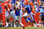 Florida RB Mack Brown finds the open hole and sprints upfield.  2014 Orange and Blue Debut.  April 12th, 2014. Gator Country photo by David Bowie.