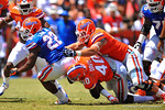 Florida RB Adam Lane Jr. is tackled by Florida LB Jarrad Davis.  2014 Orange and Blue Debut.  April 12th, 2014. Gator Country photo by David Bowie.