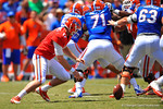Florida QB Skyler Mornhinweg scrambles for the ball after dropping the snap.  2014 Orange and Blue Debut.  April 12th, 2014. Gator Country photo by David Bowie.