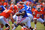 Florida RB Adam Lane Jr. gets the handoff and cuts upfild.  2014 Orange and Blue Debut.  April 12th, 2014. Gator Country photo by David Bowie.