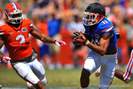 Florida WR Demarcus Robinson catches the ball and sprints to the corner.  2014 Orange and Blue Debut.  April 12th, 2014. Gator Country photo by David Bowie.