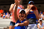 A Gator fan does the gator chomp for the camera.  2014 Orange and Blue Debut.  April 12th, 2014. Gator Country photo by David Bowie.