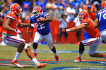 Florida RB Adam Lane Jr. finds the open hole and sprints downfield.  2014 Orange and Blue Debut.  April 12th, 2014. Gator Country photo by David Bowie.