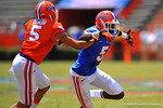 Florida WR Ahmad Fulwood sprints off the line and tries to elude the block from Florida DB Jalen Tabor.  2014 Orange and Blue Debut.  April 12th, 2014. Gator Country photo by David Bowie.