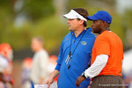 Florida Gator head coach Will Muschamp and Gator defensive backs coach Travaris Robinson look on as the Gators run through practice drills.  August 8th, 2014. Gator Country photo by David Bowie.