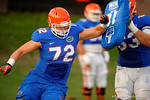 Florida OL Drew Sarvary hits the blocking shield during a practice drill.  August 8th, 2014. Gator Country photo by David Bowie.