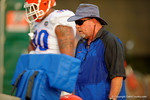 Gator defensive lines coach Brad Lawing watches on as his defensive linemen practice.  August 8th, 2014. Gator Country photo by David Bowie.