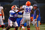 Florida OL Roderick Johnson and Florida DL Jay-nard Bostwick work with Gator defensive lines coach Brad Lawing during practice.  August 8th, 2014. Gator Country photo by David Bowie.