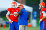 Florida Gator offensive coordinator Kurt Roper runs a drill with Jeff Driskel and the rest of the quarterbacks.  August 7th, 2014. Gator Country photo by David Bowie.