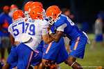 Florida Gator OL Matthew Fuchs and WR C'Yontai Lewis compete in a blocking drill during practice.  August 7th, 2014. Gator Country photo by David Bowie.