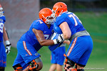 Florida OL Trenton Brown and Florida OL Tyler Moore compete during a drill during open practice.  August 7th, 2014. Gator Country photo by David Bowie.