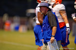 Gator defensive lines coach Brad Lawing works with the defensive line during practice.  August 7th, 2014. Gator Country photo by David Bowie.