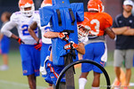 Florida DB Ben Peacock hits the sled during a practice drill.  August 7th, 2014. Gator Country photo by David Bowie.