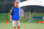 Gator offensive coordinator Kurt Roper watches on as the Gator quarterbacks compete in a drill.  August 7th, 2014. Gator Country photo by David Bowie.