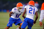 Florida Gator freshman DB Quincy Wilson tries to keep up with DB Deiondre Porter while having his hands behind his back  during a practice drill.  August 7th, 2014. Gator Country photo by David Bowie.