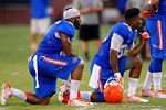 Florida Gator wide receivers Latroy Pittman Jr. and Alvin Bailey take a knee to catch a breather during practice.  August 7th, 2014. Gator Country photo by David Bowie.