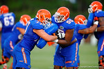 Florida Gator offensive linemen Roderick Johnson and Mike Andrew compete during a blocking drill.  August 7th, 2014. Gator Country photo by David Bowie.