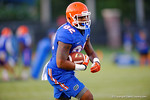 Florida Gator TE Moral Stephens runs downfield after making the catch during a practice drill.  August 7th, 2014. Gator Country photo by David Bowie.
