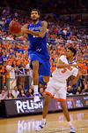 Kentucky Wildcats forward Willie Cauley-Stein flies toward the basket as Florida Gators forward Devin Robinson leans out of the way.  Florida Gators vs Kentucky Wildcats.  February 7th, 2015. Gator Country photo by David Bowie.