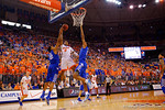 Florida Gators guard Kasey Hill drives the paint and lays in a shot over Kentucky Wildcats guard Aaron Harrison and Kentucky Wildcats forward Karl-Anthony Towns during the first half.  Florida Gators vs Kentucky Wildcats.  February 7th, 2015. Gator Country photo by David Bowie.