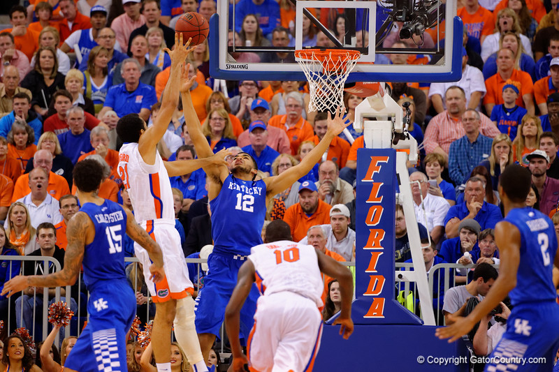 Kentucky Wildcats forward Karl-Anthony Towns goes up to try to block the shot by Florida Gators center Jon Horford during the second half.  Florida Gators vs Kentucky Wildcats.  February 7th, 2015. Gator Country photo by David Bowie.