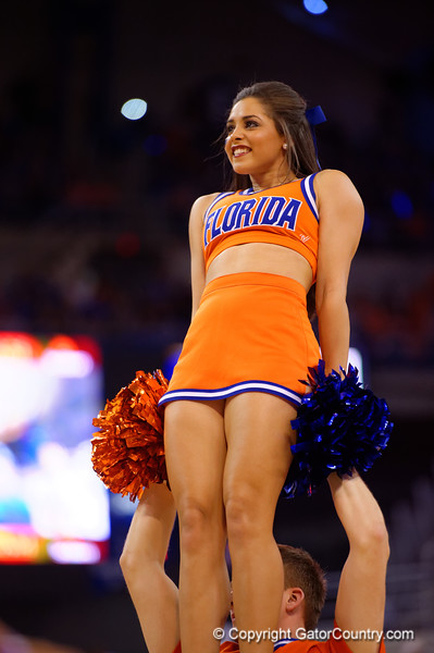 A Florida Gators cheerleader smiles to the fans during the first half.  Florida Gators vs Kentucky Wildcats.  February 7th, 2015. Gator Country photo by David Bowie.