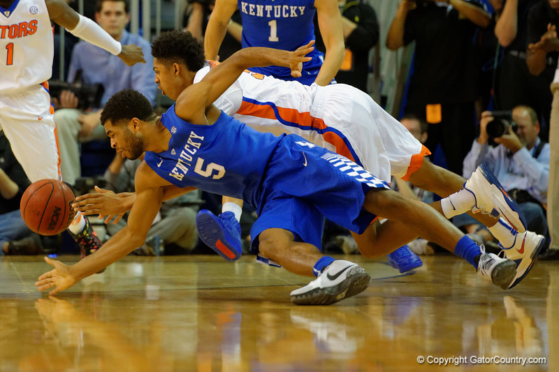 Kentucky Wildcats guard Andrew Harrison and Florida Gators forward Devin Robinson dive for a loose ball in the first half.  Florida Gators vs Kentucky Wildcats.  February 7th, 2015. Gator Country photo by David Bowie.