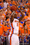 Florida Gators forward Dorian Finney-Smith hits a three-pointer from the corner during the first half.  Florida Gators vs Kentucky Wildcats.  February 7th, 2015. Gator Country photo by David Bowie.