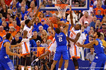 Florida Gators guard Michael Frazier II blocks a shot attempt by Kentucky Wildcats guard Aaron Harrison during the first half.  Florida Gators vs Kentucky Wildcats.  February 7th, 2015. Gator Country photo by David Bowie.