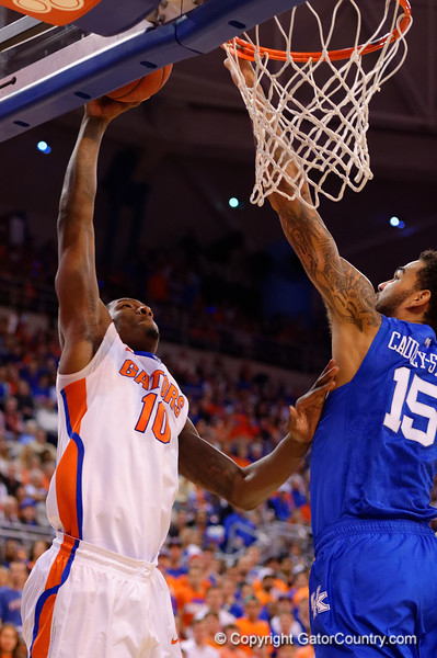 Florida Gators forward Dorian Finney-Smith shoots up and over Kentucky Wildcats forward Willie Cauley-Stein during the first half.  Florida Gators vs Kentucky Wildcats.  February 7th, 2015. Gator Country photo by David Bowie.