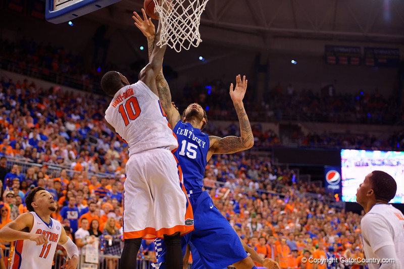 Florida Gators forward Dorian Finney-Smith blocks a shot attempt by Kentucky Wildcats forward Willie Cauley-Stein during the second half.  Florida Gators vs Kentucky Wildcats.  February 7th, 2015. Gator Country photo by David Bowie.