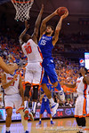 Kentucky Wildcats forward Willie Cauley-Stein leaps up toward the basket as Florida Gators forward Dorian Finney-Smith defends.  Florida Gators vs Kentucky Wildcats.  February 7th, 2015. Gator Country photo by David Bowie.