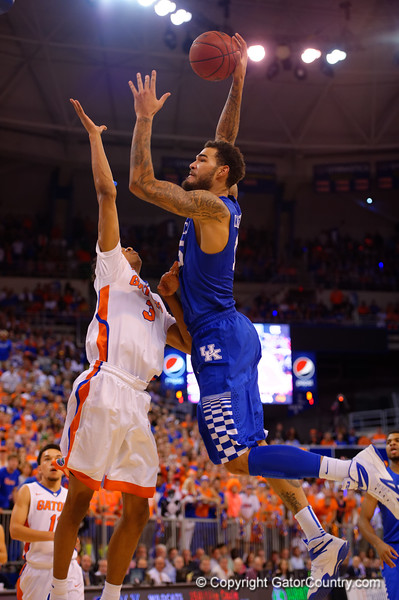 Kentucky Wildcats forward Willie Cauley-Stein flies up over Florida Gators forward Devin Robinson on his way to an ESPN top 10 plays of the week dunk.  Florida Gators vs Kentucky Wildcats.  February 7th, 2015. Gator Country photo by David Bowie.