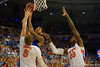 Kentucky Wildcats forward Willie Cauley-Stein drives to the basket and scores over Florida Gators forward Alex Murphy and Florida Gators forward Chris Walker.  Florida Gators vs Kentucky Wildcats.  February 7th, 2015. Gator Country photo by David Bowie.