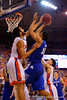 Florida Gators center Jon Horford blocks a shot by Kentucky Wildcats forward Karl-Anthony Towns.  Florida Gators vs Kentucky Wildcats.  February 7th, 2015. Gator Country photo by David Bowie.