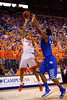 Florida Gators forward Devin Robinson floats the ball over a Kentucky player toward the basket during the first half.  Florida Gators vs Kentucky Wildcats.  February 7th, 2015. Gator Country photo by David Bowie.