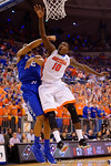 Florida Gators forward Dorian Finney-Smith fights for a rebound against Kentucky Wildcats guard Aaron Harrison during the first half.  Florida Gators vs Kentucky Wildcats.  February 7th, 2015. Gator Country photo by David Bowie.