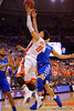 Florida Gators guard Chris Chiozza drives toward the basket while Kentucky Wildcats guard Devin Booker defends.  Florida Gators vs Kentucky Wildcats.  February 7th, 2015. Gator Country photo by David Bowie.