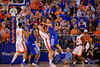 Florida Gators forward Alex Murphy steps in trying to draw a charge on Kentucky Wildcats guard Devin Booker during the first half.  Florida Gators vs Kentucky Wildcats.  February 7th, 2015. Gator Country photo by David Bowie.