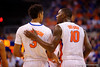 Florida Gators forward Dorian Finney-Smith has a talk with Florida Gators forward Devin Robinson during the second half.  Florida Gators vs Kentucky Wildcats.  February 7th, 2015. Gator Country photo by David Bowie.